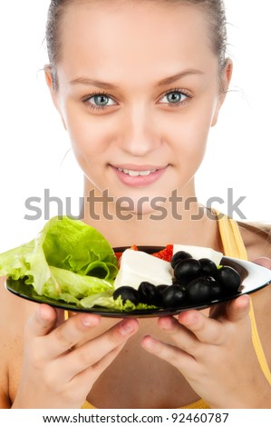 portrait of beautiful young woman smiling and eating a vegetarian salad,  young Caucasian girl holding a plate of salad, an attractive girl with a plate of healthy vegetable eating, isolated on white - stock photo
