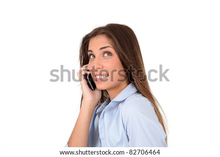Portrait of beautiful young woman talking on mobilephone - stock photo