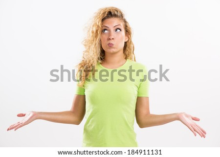 Portrait of beautiful young woman thinking and spreads his arms. White background. - stock photo