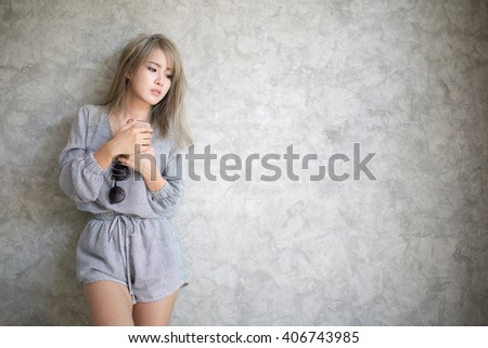 Portrait of beautiful young woman using her smart phone. - stock photo