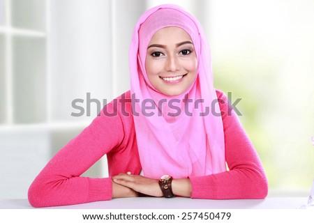 portrait of beautiful young woman wearing hijab - stock photo