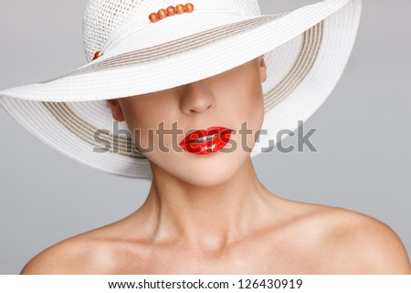 Portrait of beautiful young woman wearing straw hat