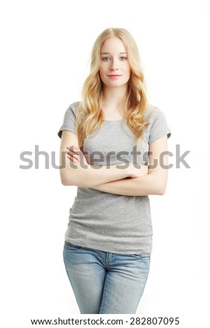 Portrait of beautiful young woman with arms crossed standing against white background while looking at camera and smiling. - stock photo