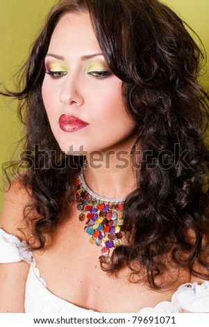 portrait of beautiful young woman with art make up - stock photo