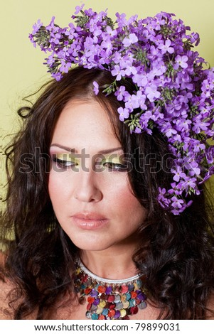 portrait of beautiful young woman with art make up and flowers - stock photo