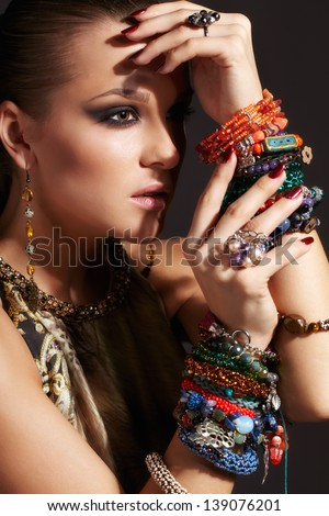 Portrait of beautiful young woman with bijouterie - stock photo