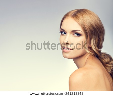 Portrait of beautiful young woman, with blank copyspace area for text or slogan. Beauty and health concept. - stock photo
