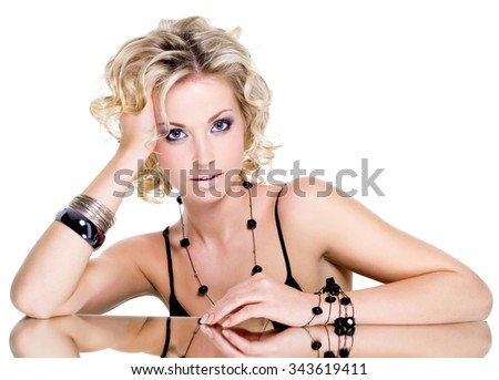 POrtrait of beautiful young woman with blond curly hair - stock photo