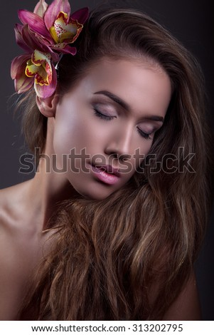 Portrait of beautiful young woman with blond hair, studio shot - stock photo