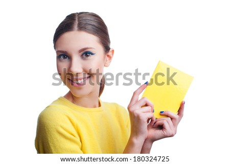 Portrait of beautiful young woman with blue make up and blue nails holding yellow blank, isolated on white background