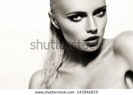 Portrait of beautiful young woman with bright make-up The Black-and-white photo.  - stock photo