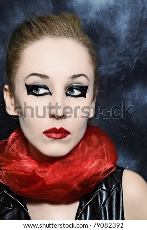 Portrait of beautiful young woman with bright makeup closeup
