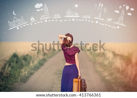 portrait of beautiful young woman with brown suitcase standing on the sky background - stock photo