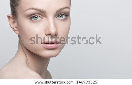 Portrait of beautiful young woman with clean and healthy face. Natural Make up - stock photo