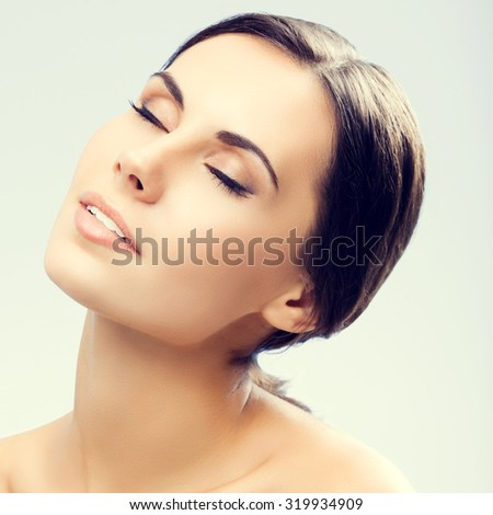 portrait of beautiful young woman with closed eyes, naked shoulders - stock photo