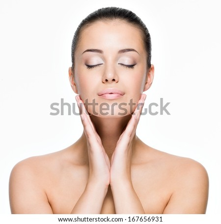Portrait of beautiful young woman with closed eyes- posing at studio  isolated on white - stock photo