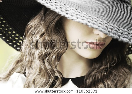 Portrait of beautiful young woman with hat - stock photo