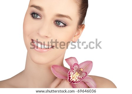 Portrait of beautiful young woman with health skin and with flower on her shoulder, isolated on white background