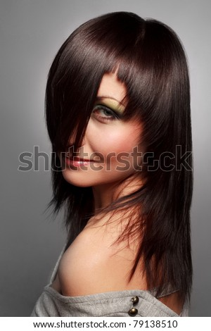 Portrait of beautiful young woman with  healthy long hair