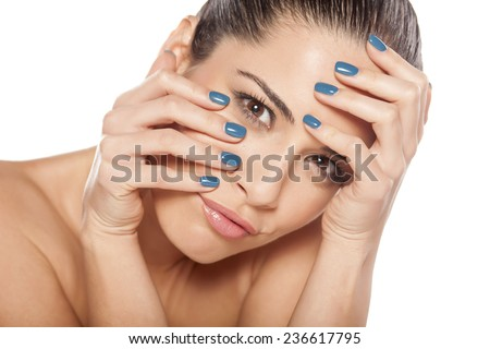 Portrait of beautiful young woman with her hands over her face