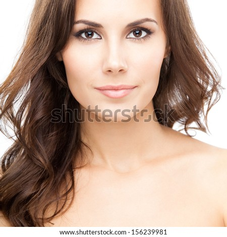 Portrait of beautiful young woman with long curly hair, isolated over white background - stock photo