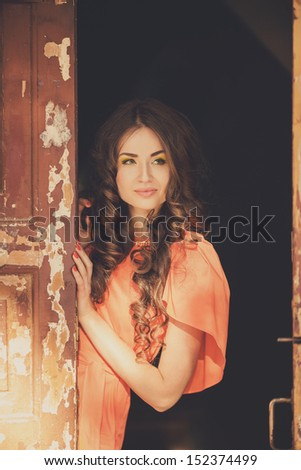 Portrait of beautiful young woman with long hair outdoors in autumn - stock photo