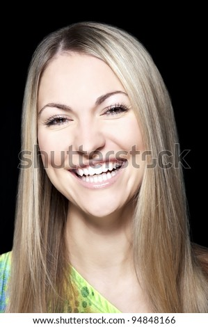Portrait of beautiful young woman with long straight hair on black background - stock photo