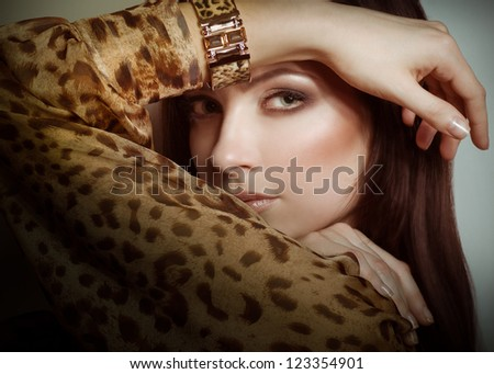 Portrait of beautiful young woman with makeup in luxury jewelry - stock photo