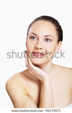 Portrait of beautiful young woman with natural look - stock photo