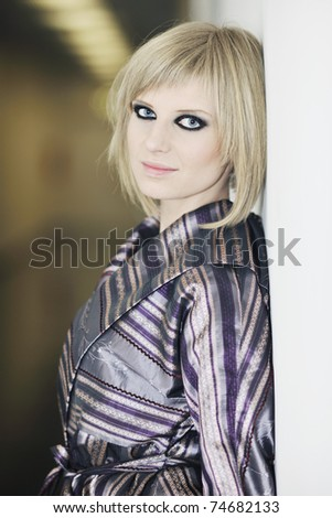 portrait of beautiful young woman with nice hairstyle and fashionable clothing and dress