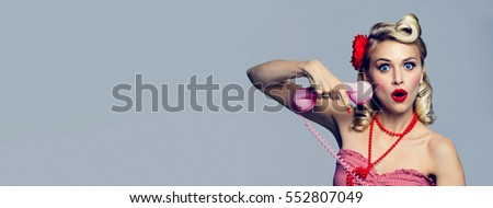 Portrait of beautiful young woman with phone, dressed in pin-up style. Caucasian blond model posing in retro fashion and vintage concept studio shoot. Horizontal banner composition.