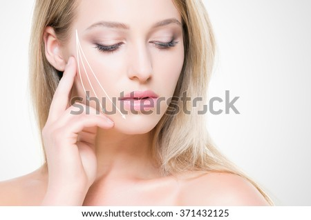 Portrait of beautiful, young woman with pure and smooth skin. Face lifting concept. - stock photo