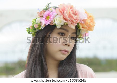 Portrait of  beautiful young woman with roses and flower in her hair. Cosmetics. Beauty, fashion.