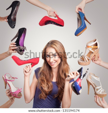 Portrait of beautiful young woman with shoes
