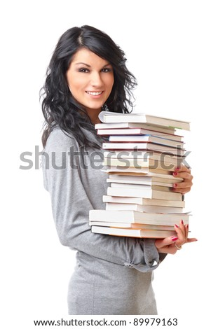 Portrait of beautiful young woman with stack of books on white background - stock photo