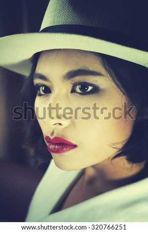 Portrait of beautiful young woman with white hat, vintage style