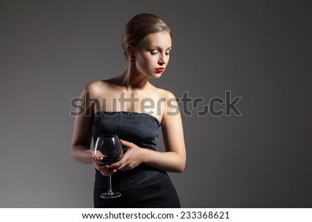 portrait of beautiful young woman with wine glass, retro stylization - stock photo