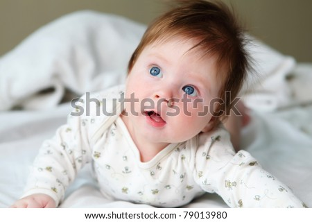 portrait of beautuful redhair infant with blue eyes - stock photo