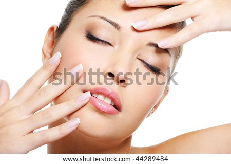 Portrait of beauty asian female  with an elegant beautiful fingernails near her face - stock photo