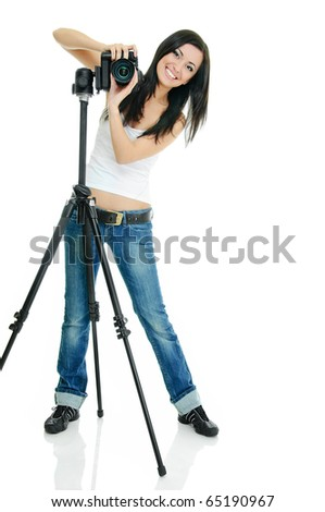 portrait of beauty brunette with camera on tripod