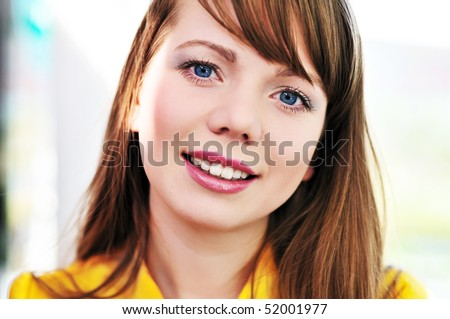portrait of beauty cheerful blue-eyed girl outdoors - stock photo