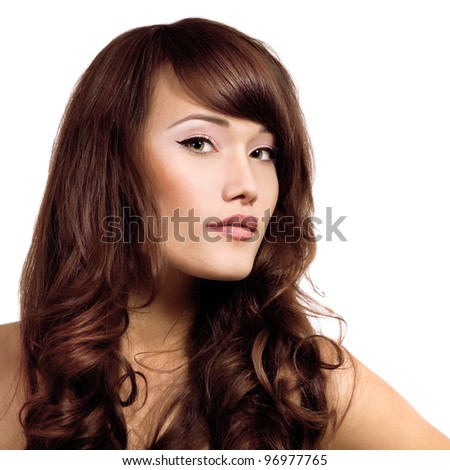 portrait of beauty face of young woman with beautiful long brown healthy hair