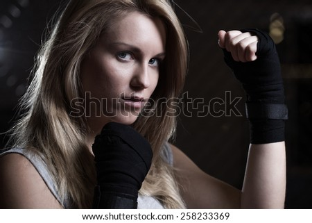 Portrait of beauty fighting girl training pugilism