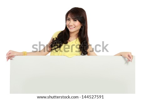 Portrait of beauty girl holding a blank white board isolated over white background
