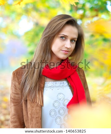 Portrait of beauty girl in autumn park - stock photo