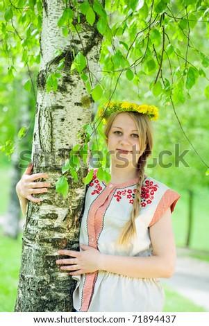 Portrait of beauty girl  in dandelion  wreath near birch - stock photo