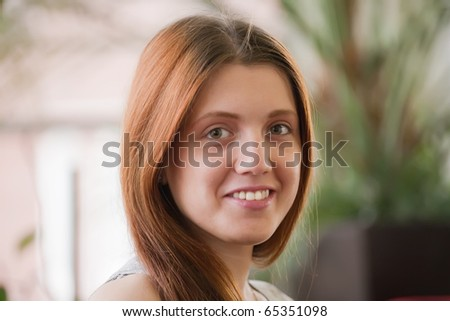 portrait of beauty  long-haired  girl  in interior