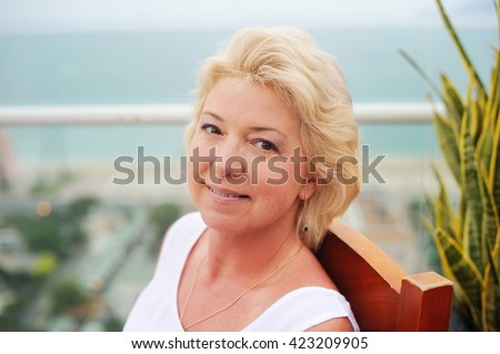 Portrait of beauty middle aged woman in the park