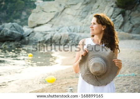Portrait of beauty middle aged woman on the beach - stock photo