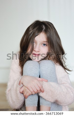 Portrait of beauty school aged  brunette kid girl  with blue eyes indoor  - stock photo